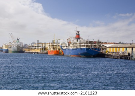 Port of Fremantle Western Australia with four ships moored at the quay. Foreground ship is a live cattle transporter.