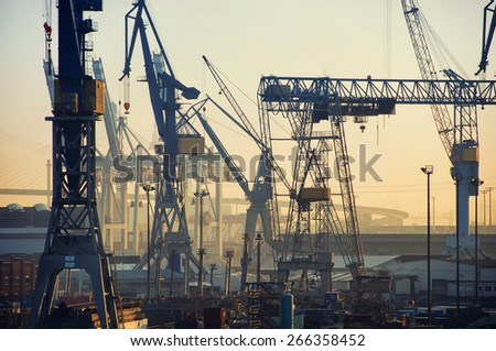 Port of Hamburg on the river Elbe in Germany in the early morning. It is the third largest in Europe and the most popular attraction in the city - stock photo