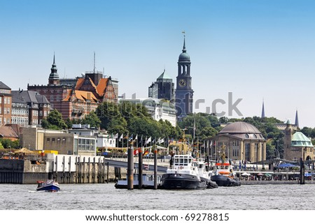 Port of Hamburg with a view of downtown - stock photo