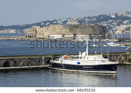 Port of Naples, Italy in Europe with ships and boats in the harbor and buildings and houses in the background. - stock photo