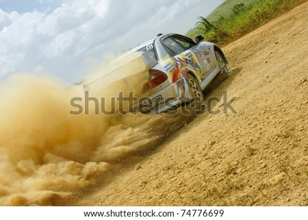 PORT OF SPAIN- APRIL 2: Action during the Trinidad and Tobago 2011 Motor Car Rally meet April 2, 2011 in Cipero, Trinidad & Tobago.  It is the largest motor sport event in the country. - stock photo