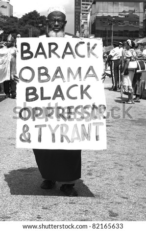 PORT OF SPAIN - AUGUST 1: Anti Obama sentiments during the Celebration of Emancipation Day which commemorates the abolition of Slavery August 1, 2011 in Port Of Spain, Trinidad & Tobago. - stock photo
