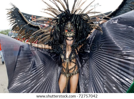 PORT OF SPAIN, TRINIDAD - MARCH 8: A female Masquerader enjoys herself in the Harts Carnival presentation 'Planet Rock', March 8, 2011 in Port of Spain, Trinidad.
