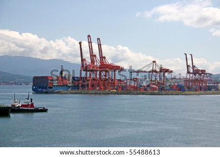 Port of Vancouver harbor container terminal and crane. - stock photo