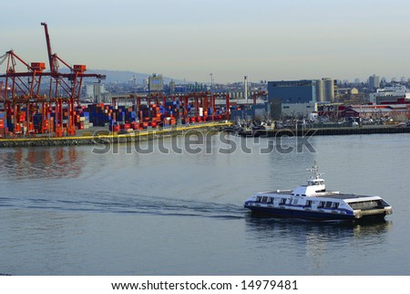 Port of Vancouver with container cranes and Seabus arriving - stock photo