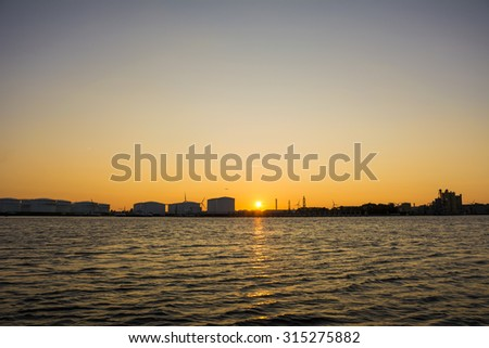 Port silhouette during sunset. - stock photo