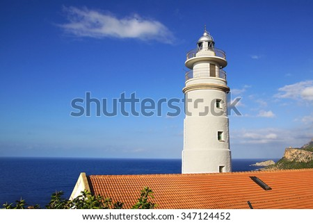 PORT SOLLER, MALLORCA, SPAIN - OCTOBER 14, 2015: Lighthouse on the rock at Cape Gros. Two lighthouses sit on the headlands on either side of the bay.  - stock photo