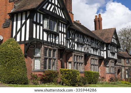 PORT SUNLIGHT, MERSEYSIDE/UK - JUNE 11, 2015: Arts and crafts style architecture in garden village on Wirral. The village contains 900 Grade II listed buildings and is now a Conservation Area in 1978. - stock photo
