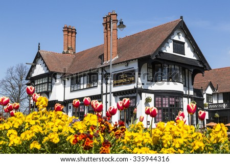 PORT SUNLIGHT, MERSEYSIDE/UK - JUNE 11, 2015: The Bridge Inn Hotel in the garden village on Wirral. The Bridge Inn (1900) was designed Grayson and Ould, was originally built as a temperance hotel. - stock photo