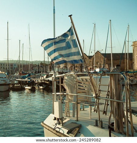 Port, the Greek flag and boats. Impressions of Greece - stock photo