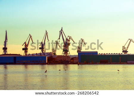 Port warehouse with cargoes and containers - stock photo
