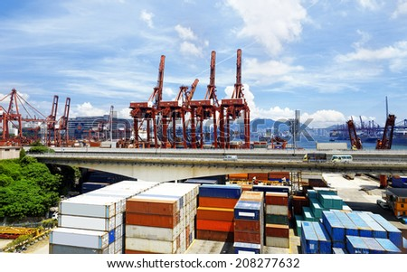 Port warehouse with containers and industrial cargoes at day - stock photo
