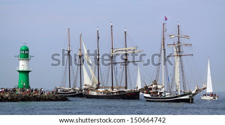 PORT WARNEMUENDE, GERMANY - AUGUST 10 Old dutch Sailing ships Banjaard, Ide Min and Hendrika Bartelds arrive on August 10, 2013 for the 23. Hanse-Sail at port Rostock, Mecklenburg-Vorpommern, Germany - stock photo