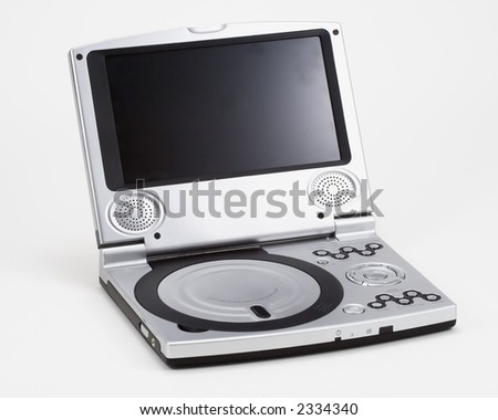 Portable DVD player with small screen and silver colored body - stock photo