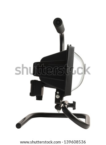 Portable halogen construction lamp with a handle isolated over white background, side view - stock photo