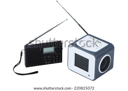 Portable radio receivers with alarm, card-reader, amplifier,  remote control and MP3 player isolated on a white background - stock photo