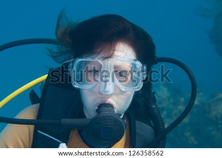 Portair of a female scuba diver in the Bahamas - stock photo