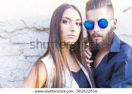 Portait of a beautiful young matching hipster couple.