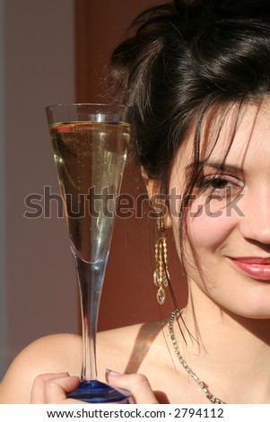 Portait women with glass champagne.