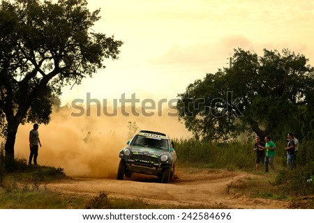 PORTALEGRE, PORTUGAL - NOV 1 : Portuguese driver Ricardo Porem and his codriver Manuel Porem in a Mini All4 Racing race in the 28th Baja Portalegre 500, on Nov 1, 2014 in Portalegre, Portugal. - stock photo