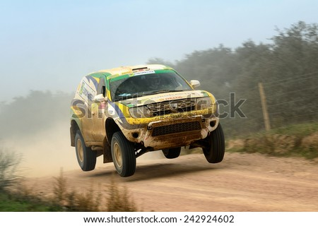 PORTALEGRE, PORTUGAL - NOV 1 : Spanish driver Enrique Bonafonte and his codriver Antonio Saraiva in a Dacia Duster Proto race in the 28th Baja Portalegre 500, on Nov 1, 2014 in Portalegre, Portugal. - stock photo