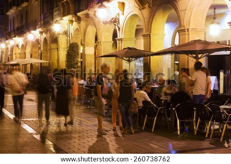 Portales street with restaurants in evening. Logrono, Spain - stock photo
