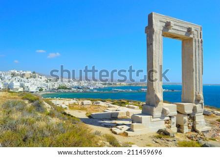 Portara - ruins of ancient temple of Delian Apollo on Naxos island, Cyclades archipelago, Greece - stock photo