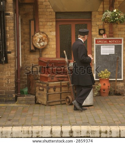 porter on platform - stock photo