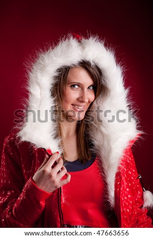 Portfait of beautiful woman wearing hooded winter red jakcet - stock photo