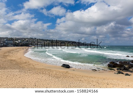 Porthmeor beach St Ives Cornwall England with white waves breaking towards the shore and known for surfing and Tate art gallery - stock photo