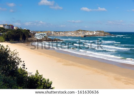 Porthminster beach with St Ives Cornwall in the background and white waves and blue sea and sky on a beautiful summer day - stock photo
