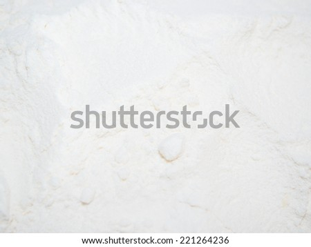 Portion of all purpose flour ready for mixing a cake dough - stock photo