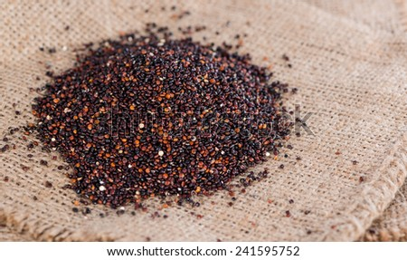 Portion of black Quinoa (detailed close-up shot) on rustic background - stock photo