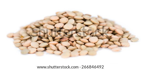 Portion of brown Lentils isoalted on pure white background - stock photo