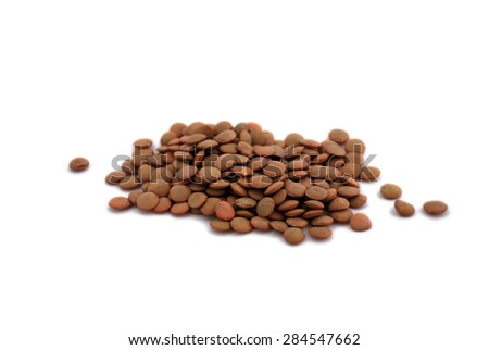 Portion of brown Lentils isolated on pure white background  - stock photo