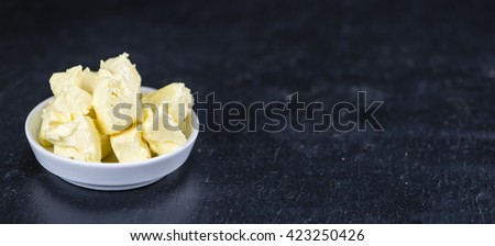 Portion of Butter on a slate slab (selective focus; close-up shot) - stock photo