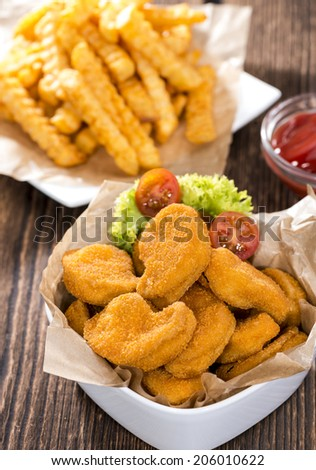 Portion of Chicken Nuggets with Chips (detailed close-up shot)