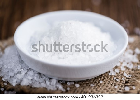 Portion of Coarse Salt on vintage background (selective focus; close-up shot) - stock photo