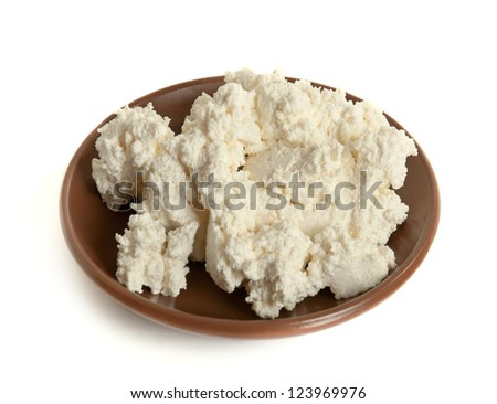 Portion of cottage (curd) cheese isolated on white - stock photo