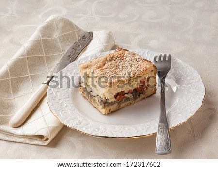 Portion of English cheese and mustard souffle stuffed with vegetables on a plate - stock photo