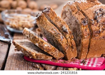 Portion of fresh baked Walnut Bread on dark wooden background - stock photo