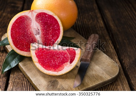Portion of fresh Grapefruit on an old wooden table (close-up shot)