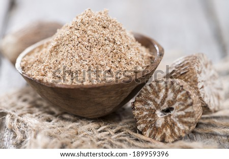 Portion of fresh grated Nutmegs (close-up shot) - stock photo