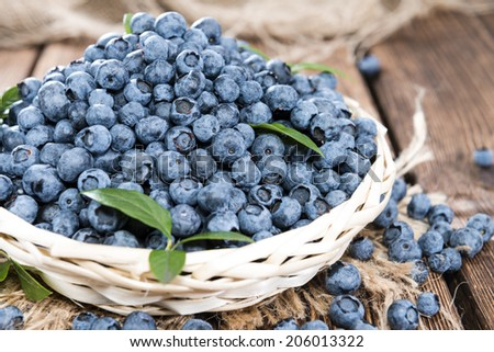 Portion of fresh harvested Blueberries (detailed close-up shot) - stock photo