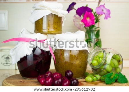Portion of fresh homemade gooseberry and cherry Jam - stock photo