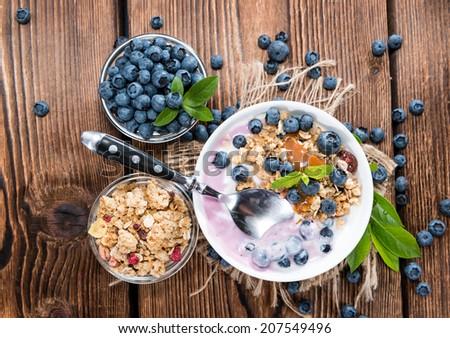 Portion of fresh made Blueberry Yogurt with fresh fruits - stock photo