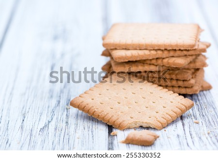 Portion of fresh made Butter Biscuits on wooden background - stock photo