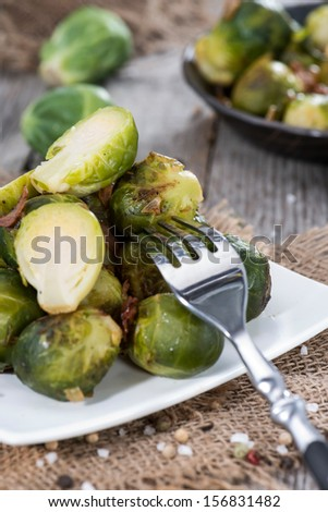 Portion of fried Brussel Sprouts with Ham and Onions - stock photo