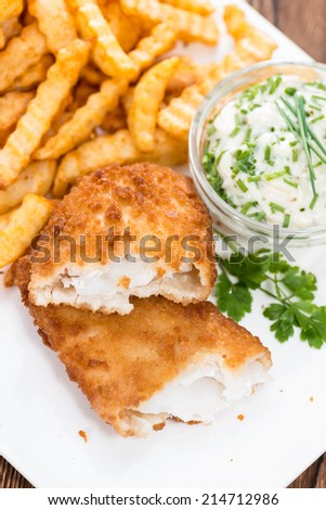 Portion of Fried Salmon with Chips and homemade remoulade - stock photo