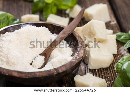 Portion of grated Parmesan Cheese on dark wooden background - stock photo